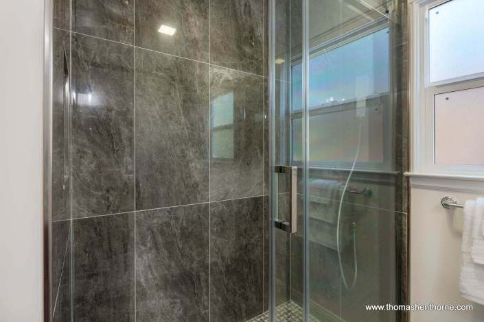 tile work and glass shower door