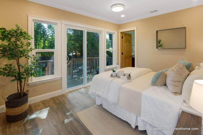 Master bedroom with sliding glass doors out to deck