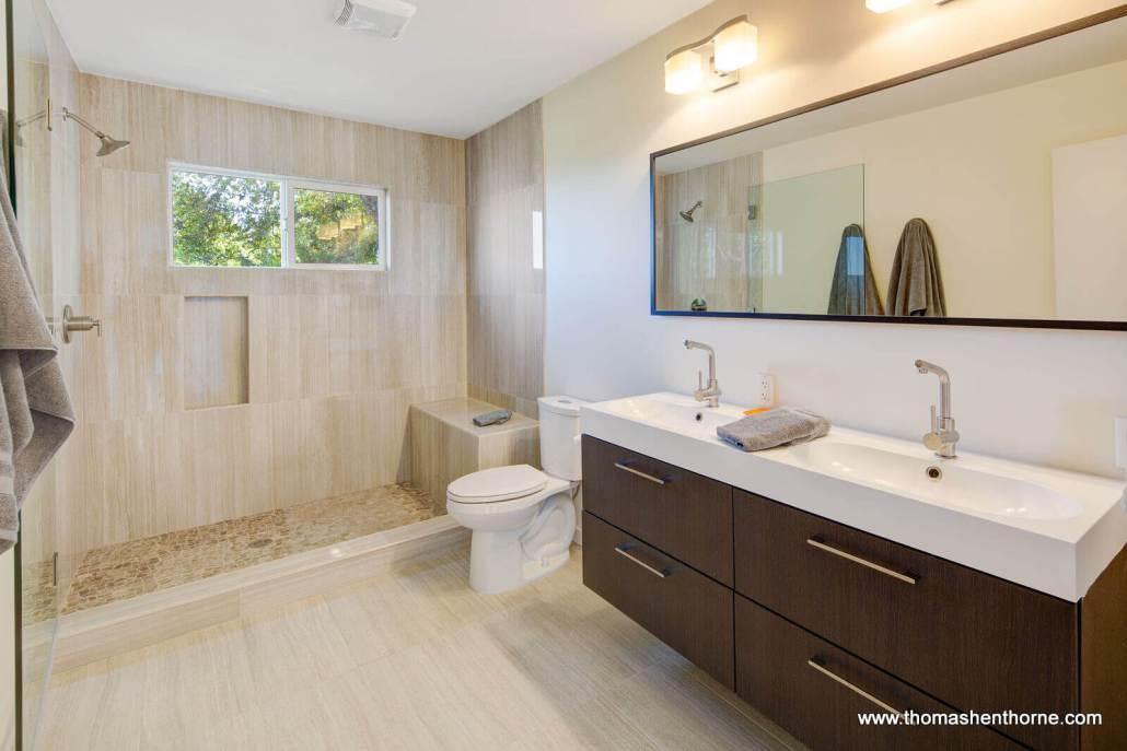 Modern bathroom with dual vanity