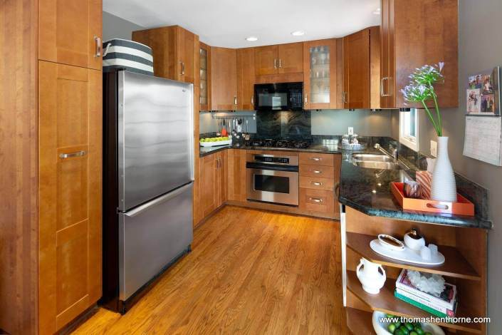 Kitchen with granite countertops and stainless appliances