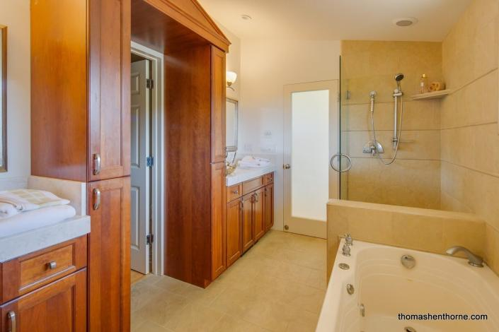 Master bathroom with jetted tub and glass enclosed shower