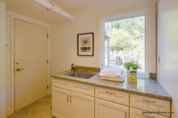 laundry room sink with granite counter