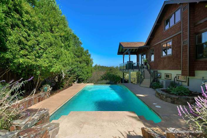 Swimming pool and house with shingles