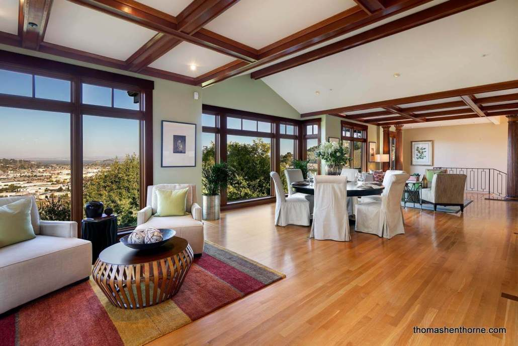 Room with hardwood floors and large windows with view