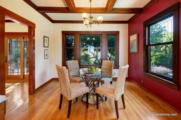 round glass table with leaded windows and coffered ceilings