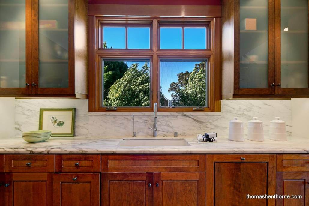Kitchen with marble countertops and frosted glass cabinets