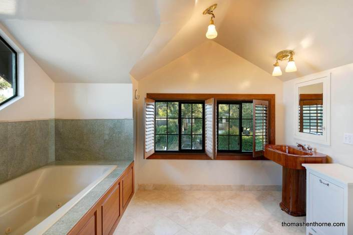 Bathroom with wood sink and jetted tub