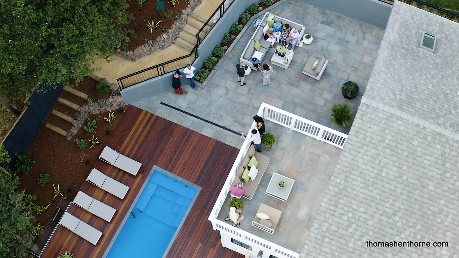 Premiere party aerial shot of home and pool