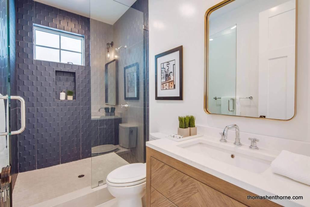 Bathroom with glass shower / tub surround
