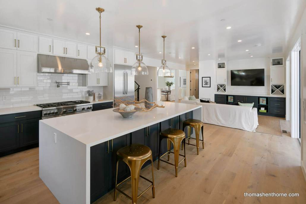Modern kitchen with stainless appliances and large island