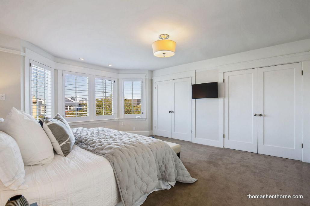 master bedroom with two closets and large windows