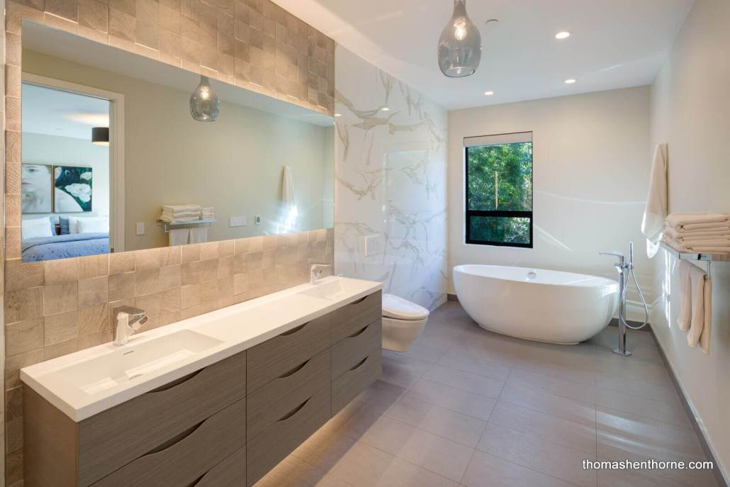 Master bathroom with dual vanity and soaking tub