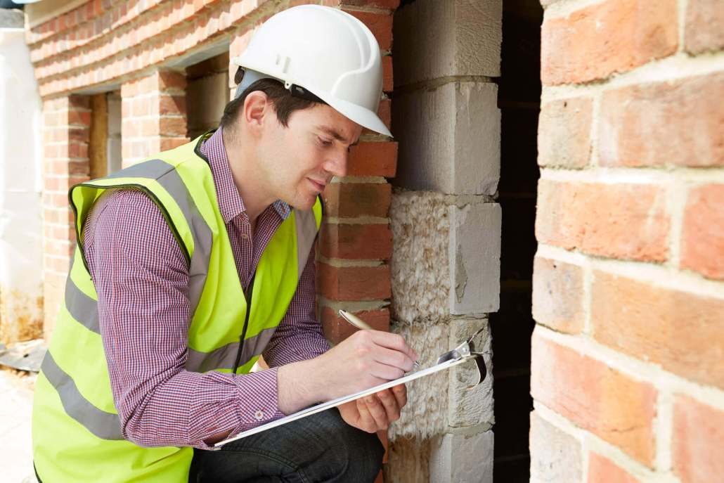 Presale home inspections article man inspecting a home