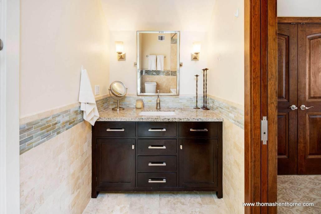 Restoration Hardware dark wood vanity with granite countertop