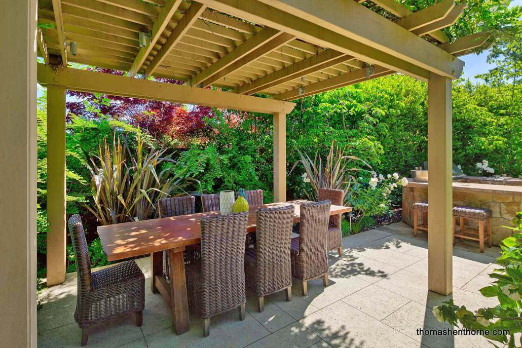 Outdoor Dining Table Under Trellis