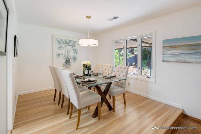 dining room with glass table and six chairs