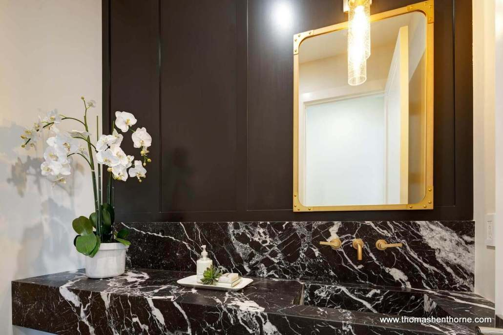 powder room with marble counter