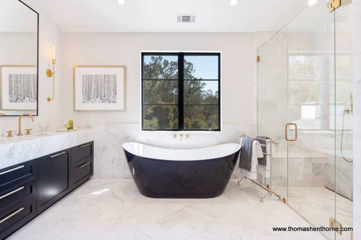 Luxury bathroom with marble countertops and soaking tub
