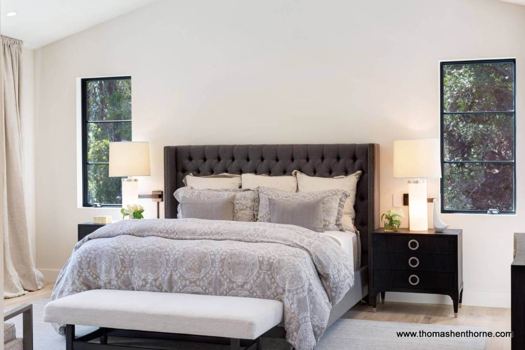 Master bedroom with two windows on either side of bed