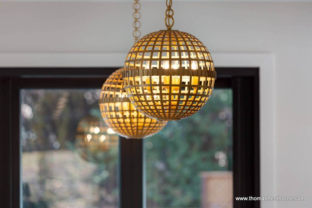 Closeup of two round pendant light fixtures