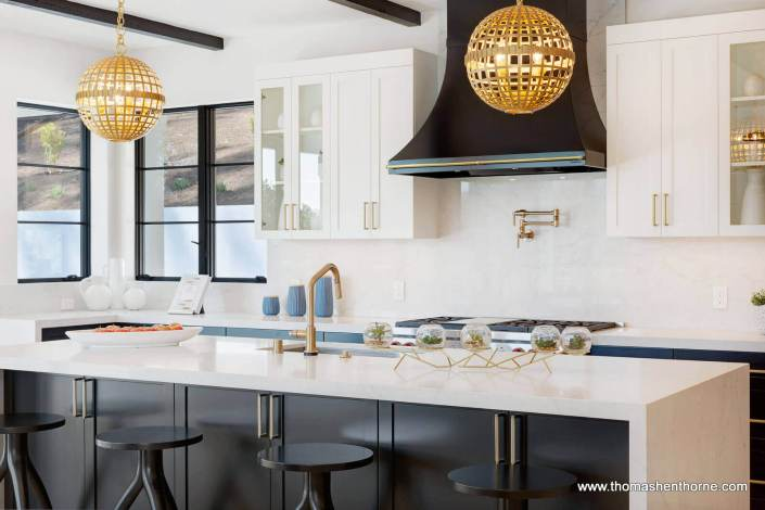 Marble kitchen island with 4 stools and two light fixtures above