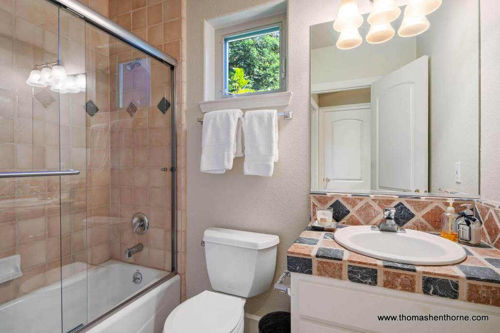 Bathroom with tub shower combination sink and toilet