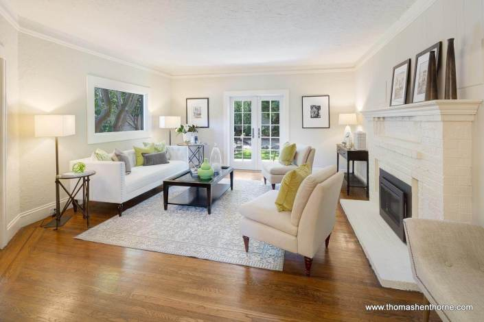 living room with fireplace white brick
