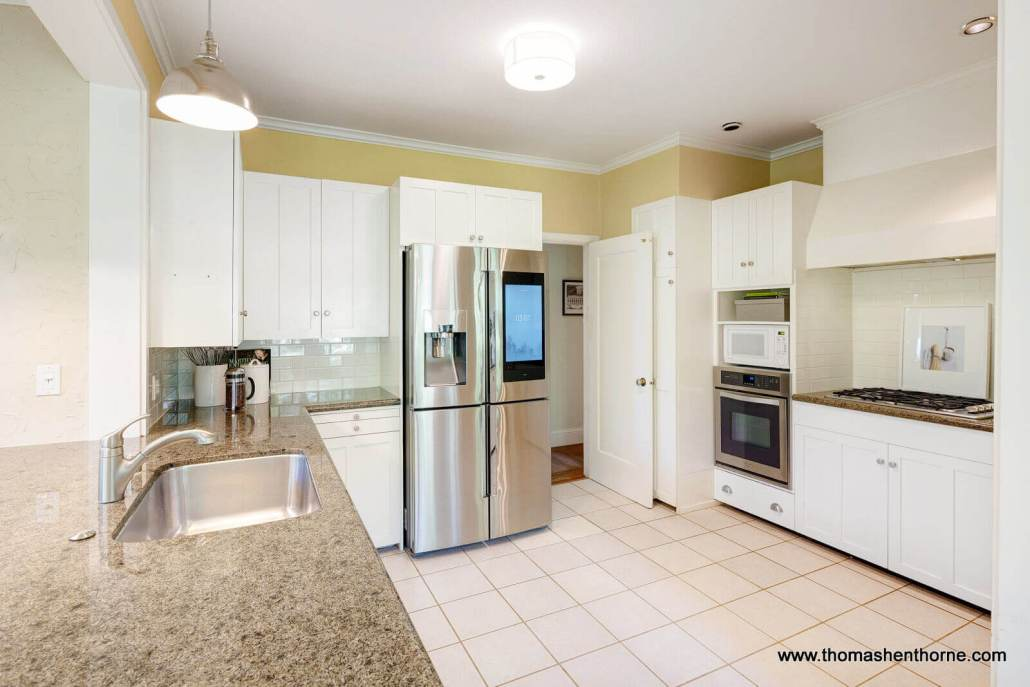 Kitchen with stainless appliances and tile floor