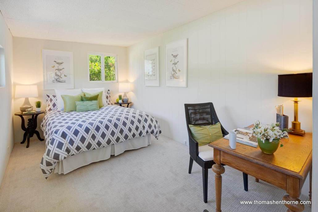 master bedroom with bed and window
