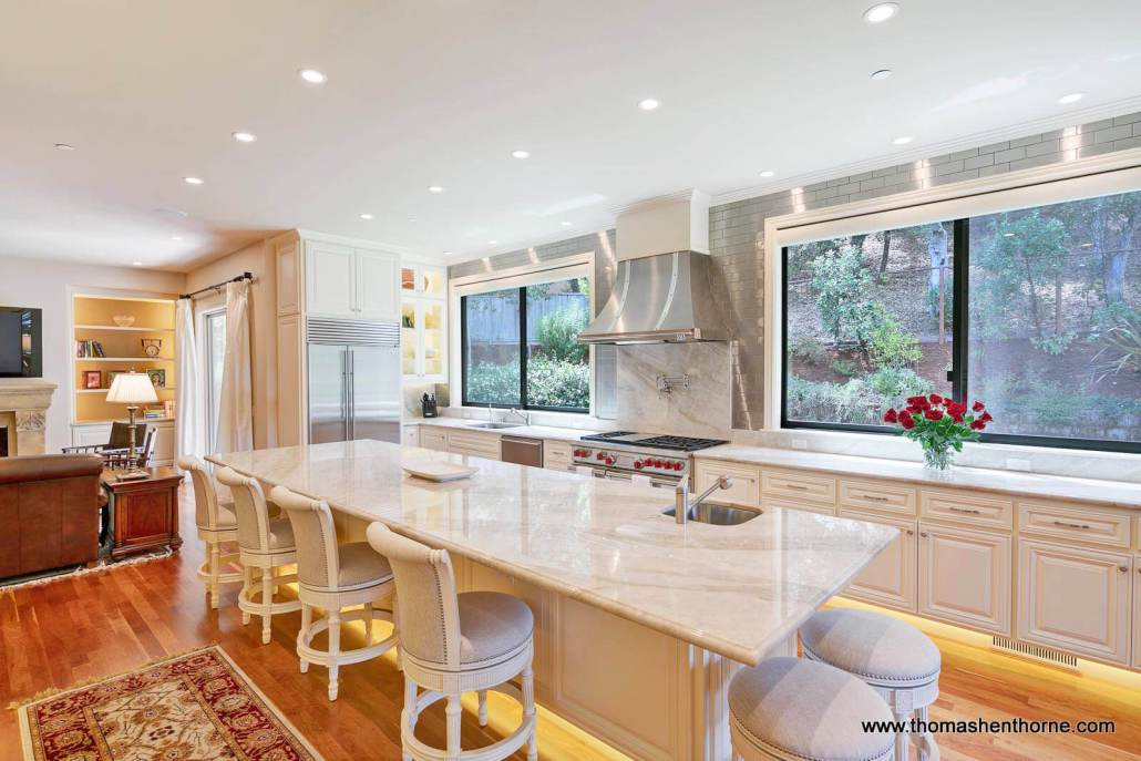 Luxury kitchen with stainless appliances and large center island