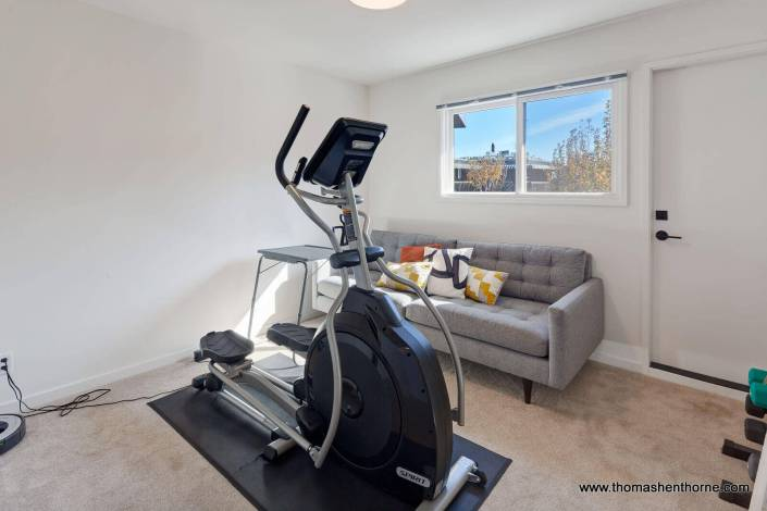 bedroom with elliptical machine