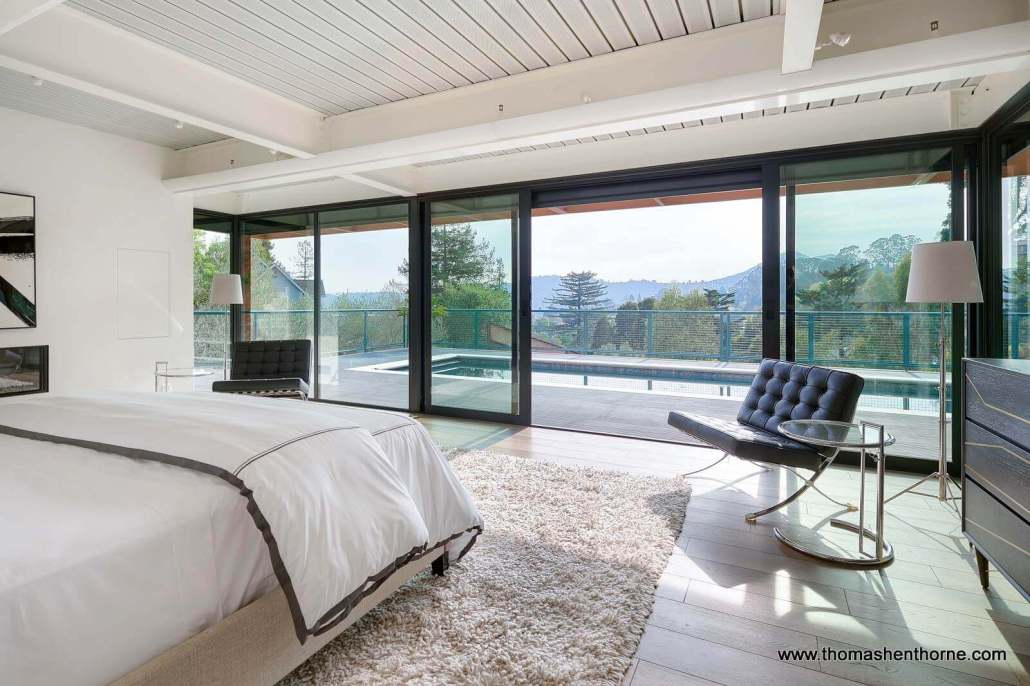 bedroom with sliding doors and view
