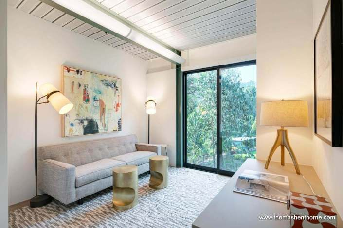 room with sofa and two lamps