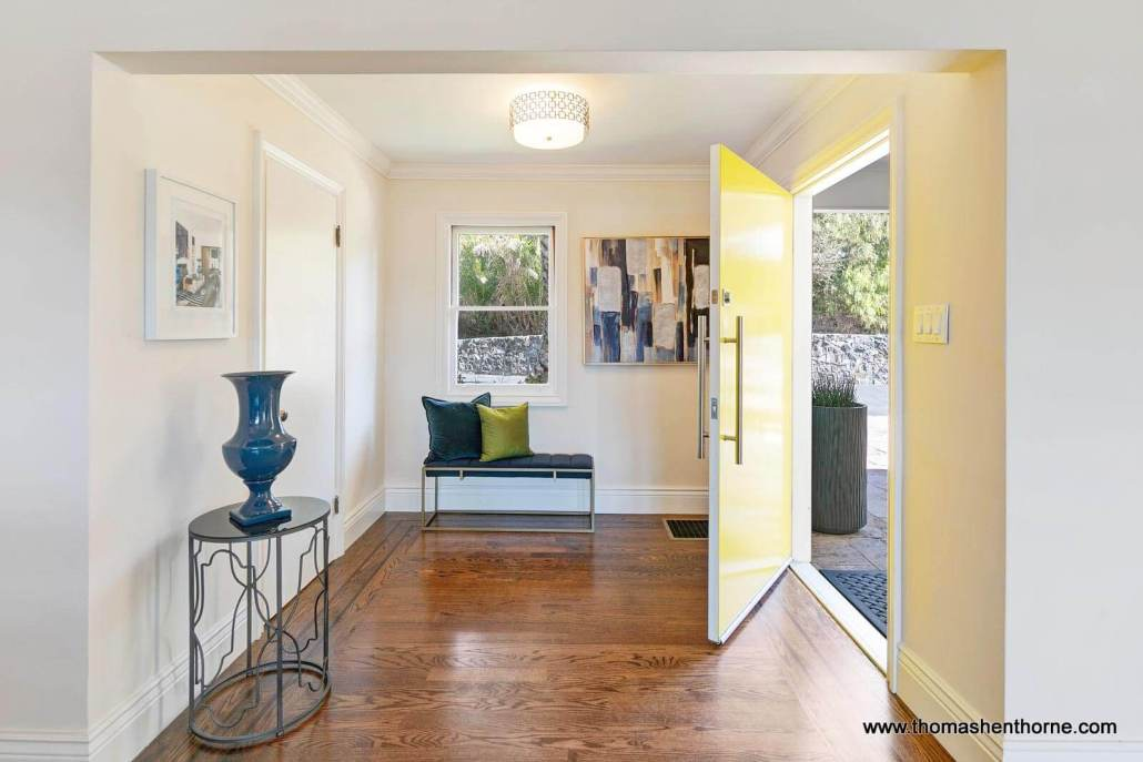 foyer with yellow entry door