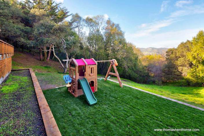 play structure on level lawn area
