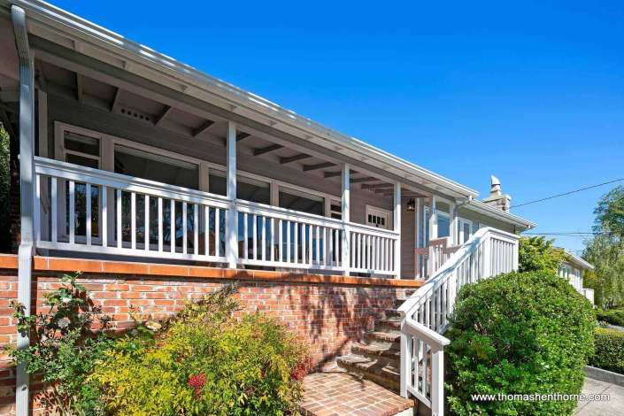 home with front porch and railing