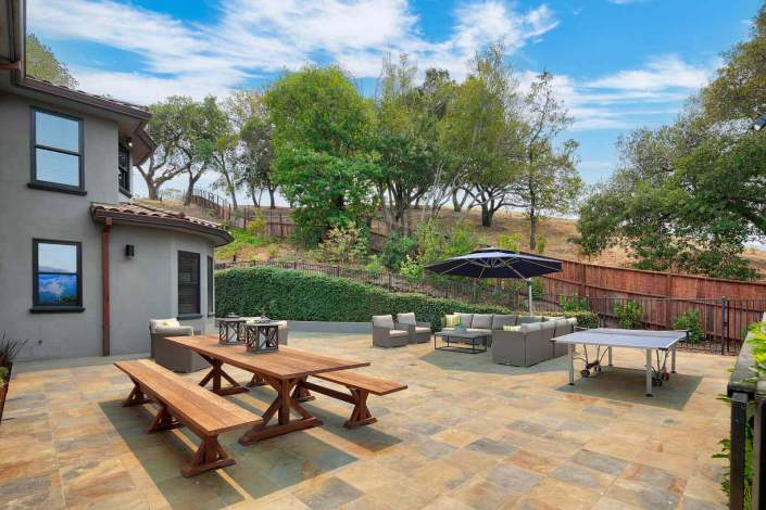 Outdoor table with bench seating on stone patio