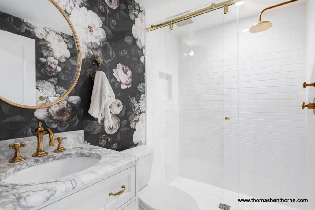 sink and shower tub with brass fixtures