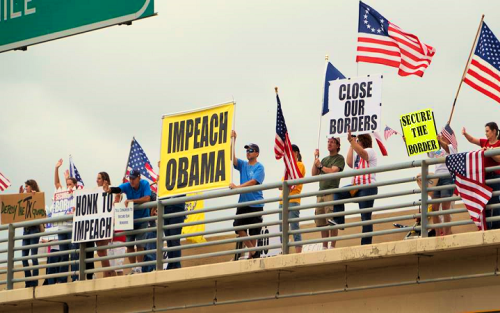 "Thomas More Law Center Obtains Judgment Protecting Overpasses for America's Right to Display ""Impeach Obama"" and ""Secure the Border"" Signs on Dallas Overpasses"