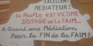 Pancarte Ouagadougou 8 avril 2011 (photo Amidou Kabré)
