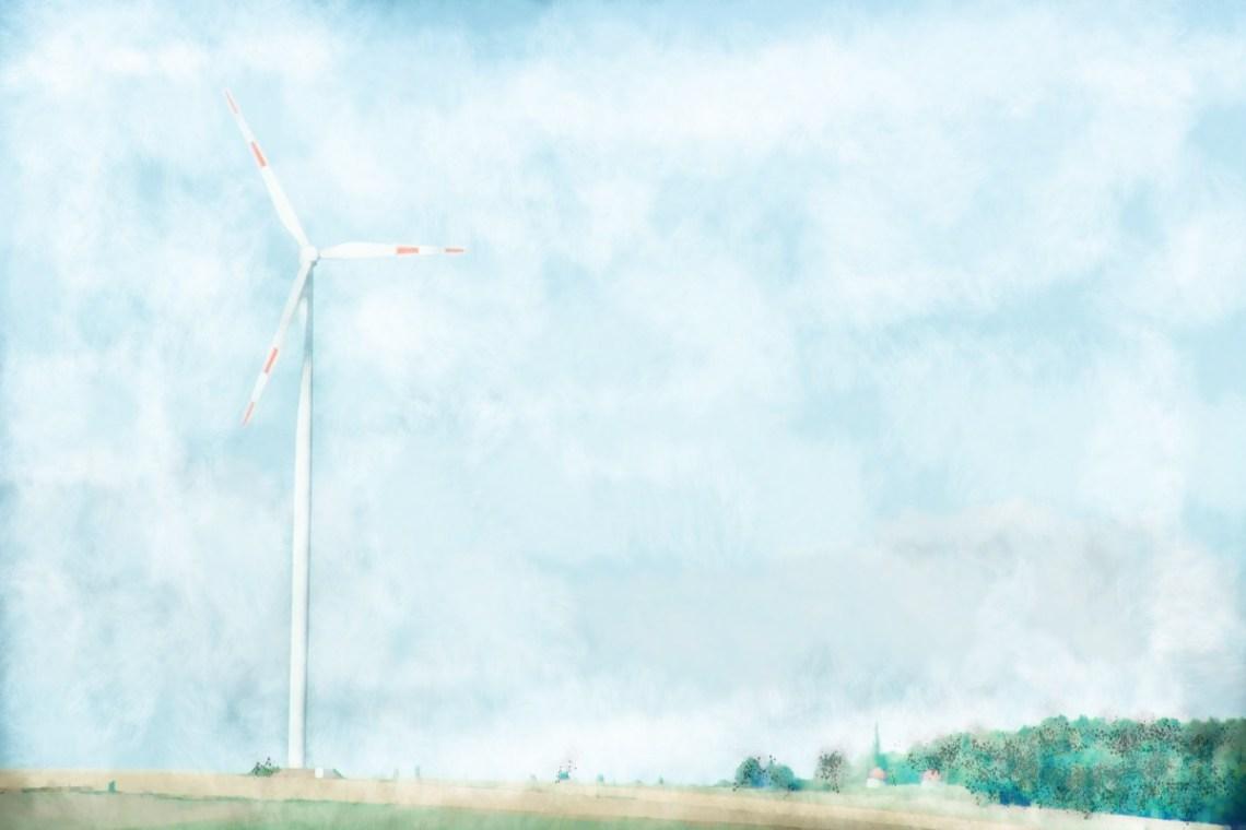 Windkraftrad auf einem Feld © Tom Rübenach