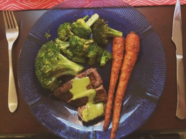 Flank steak with chimichurri sauce. Sides of pan-seared broccoli and balsamic marinated & roasted carrots.