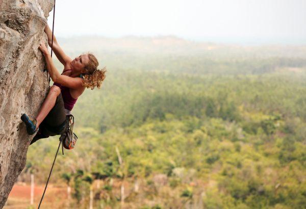 Mountain Extreme Rock Climbing Woman