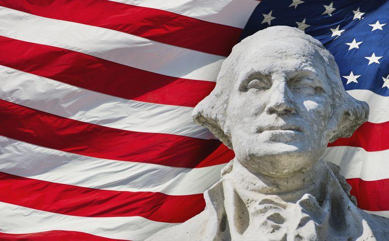 USA, New York City, Washington Square Park, George Washington monument with American flag in background