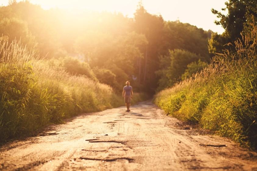 USA, Connecticut, Man walking in sunlight