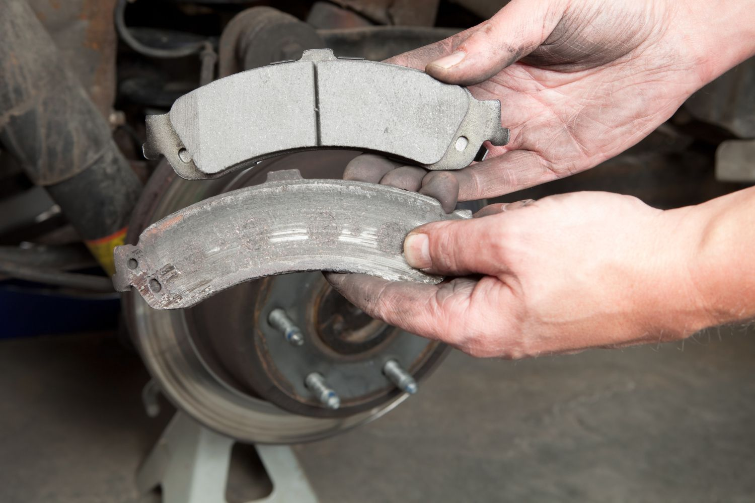 hight resolution of comparing worn and new brake pads