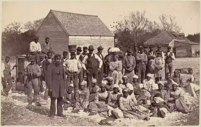 Photograph of slaves on a plantation.