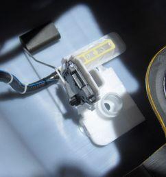 cutaway fuel tank showing fuel sending unit [ 1500 x 1001 Pixel ]