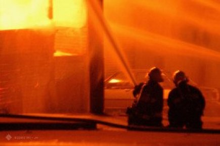 Firefighters Putting Out Fire at Burning Building