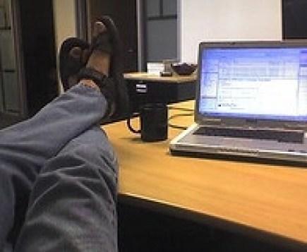 Slacker with Feet on Desk